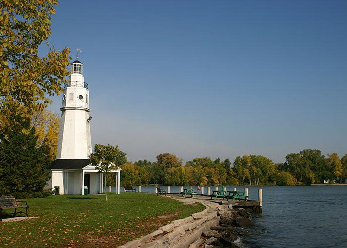 Neenah White Light House Blue Sky Water Greeting Card featuring the photograph Neenah Light House by Jack G Brauer
