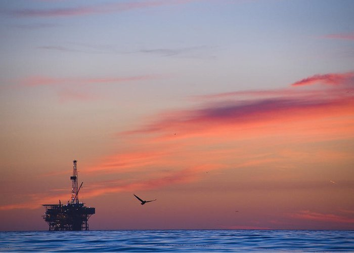 Sunset Greeting Card featuring the photograph Offshore Oil And Gas Rig In The Pacific by James Forte
