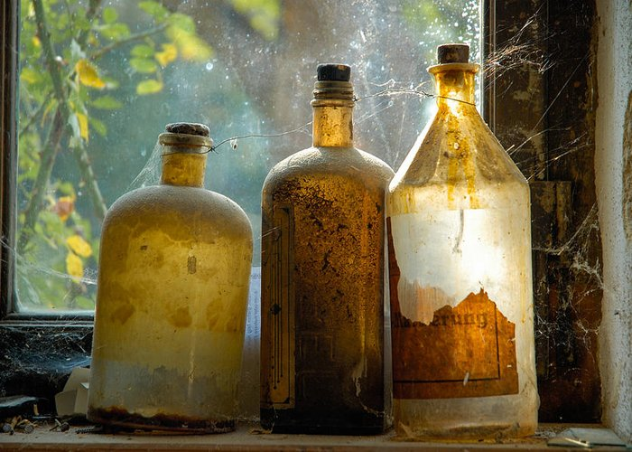 Bottles Greeting Card featuring the photograph Old And Dusty Glass Bottles by Matthias Hauser
