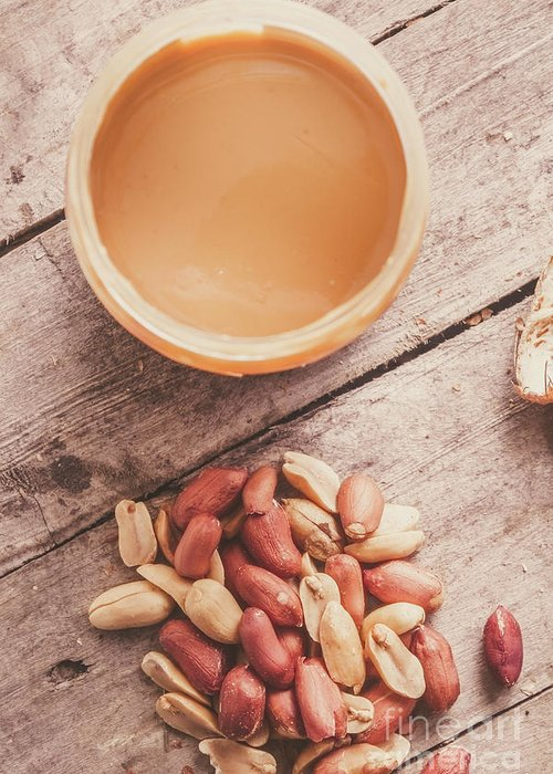 Peanuts Greeting Card featuring the photograph Peanut Butter Jar With Peanuts On Wooden Surface by Jorgo Photography - Wall Art Gallery