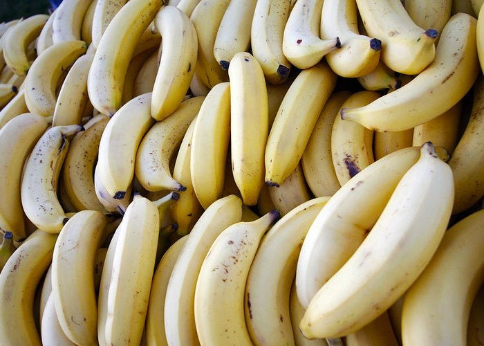 Bananas Greeting Card featuring the photograph Pile Of Bananas by PhotographyAssociates