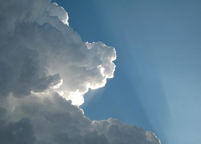 Clouds Greeting Card featuring the photograph Puffy White Clouds by Liz Vernand
