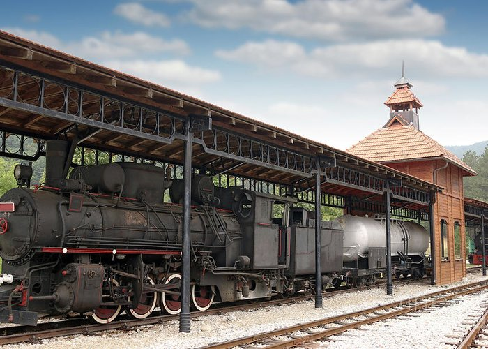 Train Greeting Card featuring the photograph Railway Station With Old Steam Locomotive by Goce Risteski
