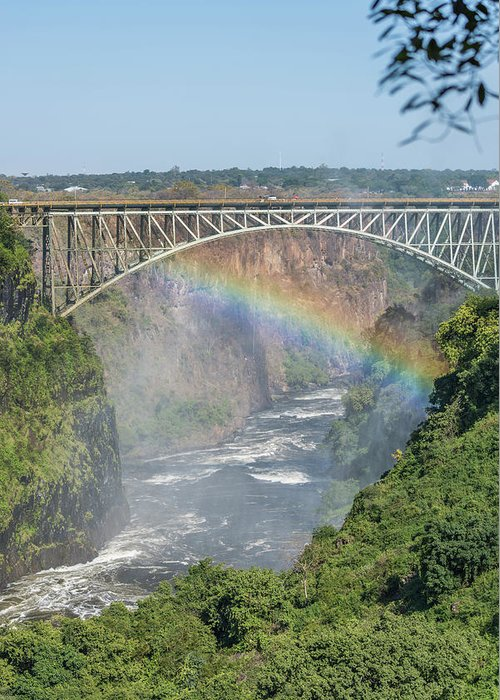 Africa Greeting Card featuring the photograph Rainbow Crossing Gorge Beneath Victoria Falls Bridge by Ndp