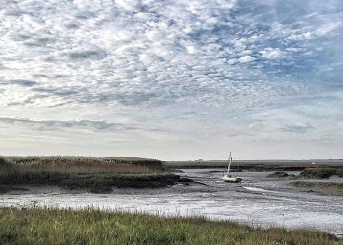 Beautiful Greeting Card featuring the photograph Salt Marsh And Creek, Brancaster by John Edwards