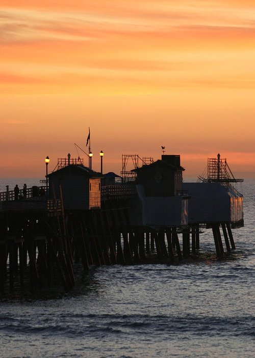 Sunset Greeting Card featuring the photograph San Clemente Pier Sunset by Brad Scott