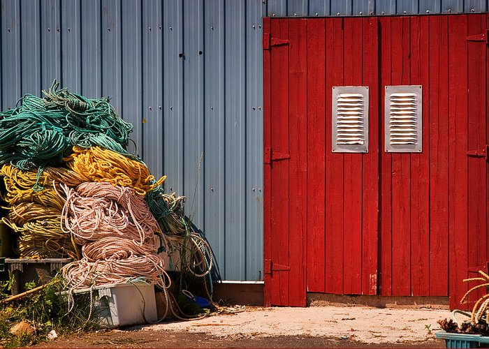 Travel Greeting Card featuring the photograph Shed Doors And Tangled Nets by Louise Heusinkveld