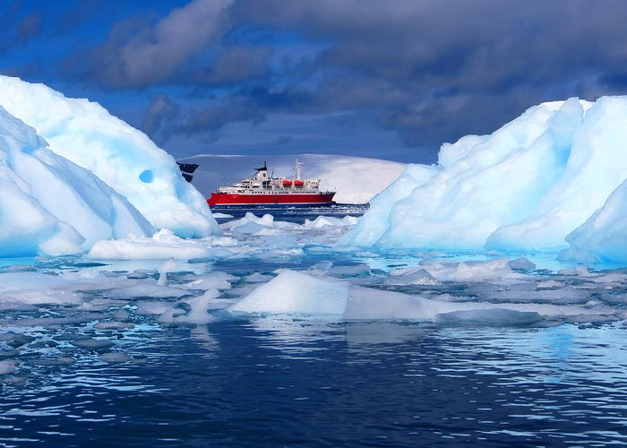 Kayaking Greeting Card featuring the photograph Ship In Between Icebergs by Harry Coburn