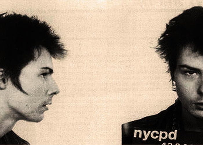 Sid Vicious Mugshot Greeting Card featuring the photograph Sid Vicious Mugshot by Bill Cannon