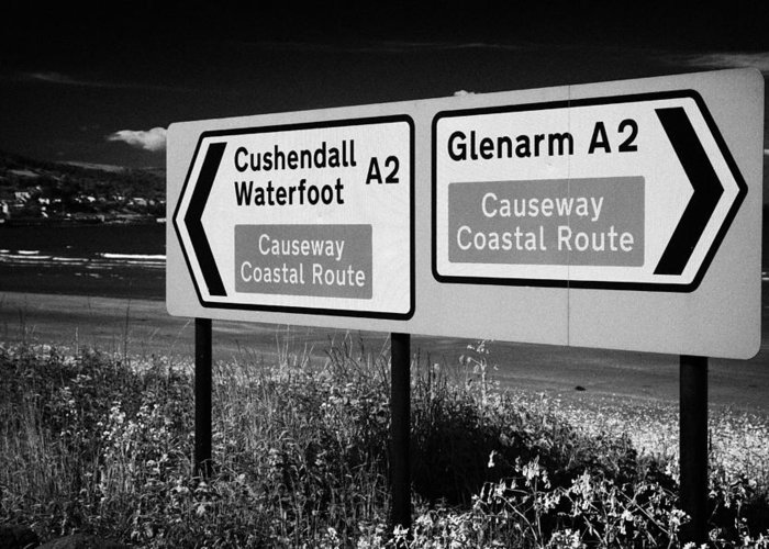 Sign Greeting Card featuring the photograph Signposts For The Causeway Coastal Route At Carnlough Between Cushendall And Glenarm County Antrim by Joe Fox