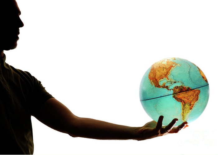 People Greeting Card featuring the photograph Silhouette Of Man Holding Globe by Sami Sarkis