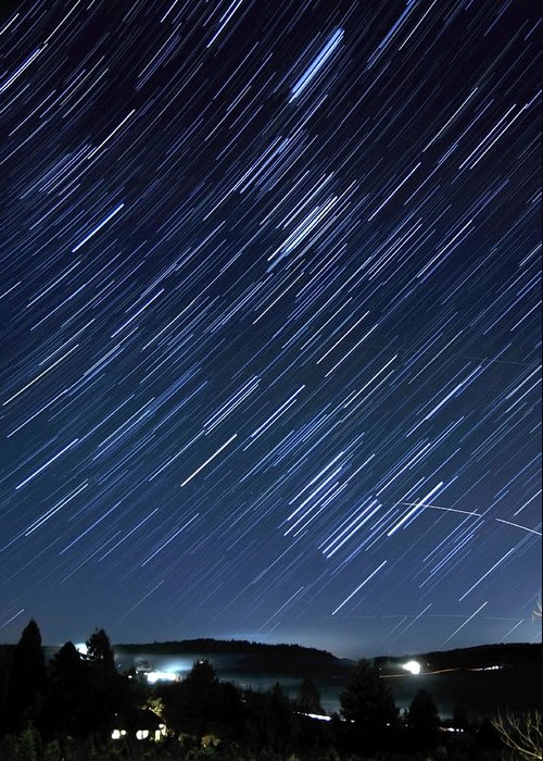 Blue Greeting Card featuring the photograph Star Trails Long Exposure At Night by Evan Sharboneau