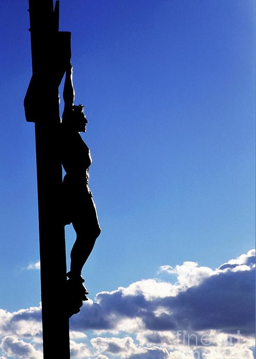 Christ Greeting Card featuring the photograph Statue Of Jesus Christ On The Cross Against A Cloudy Sky by Sami Sarkis