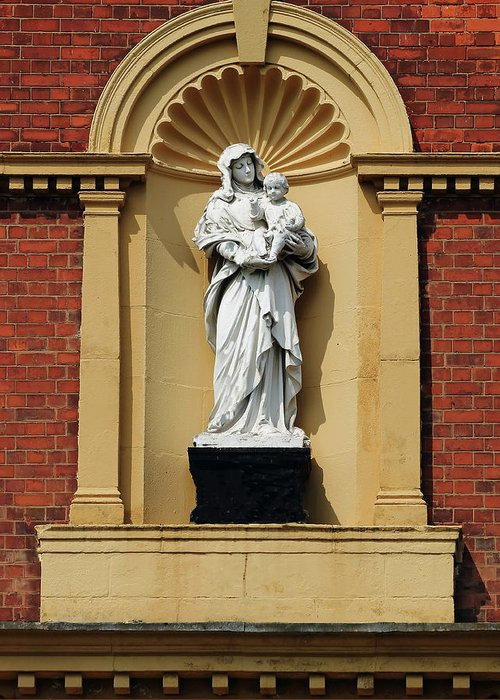 Statue Mother And Child Red Brick Sandstone Sculpture Infant Care Home Orphanage Shadow White Black Plinth Arch Greeting Card featuring the photograph Statue Of Mother And Child by Jeff Townsend