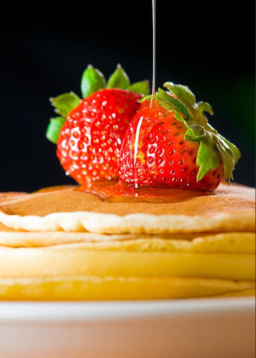 Berries Greeting Card featuring the photograph Strawberry Butter Pancake With Honey Maple Sirup Flowing Down by Ulrich Schade