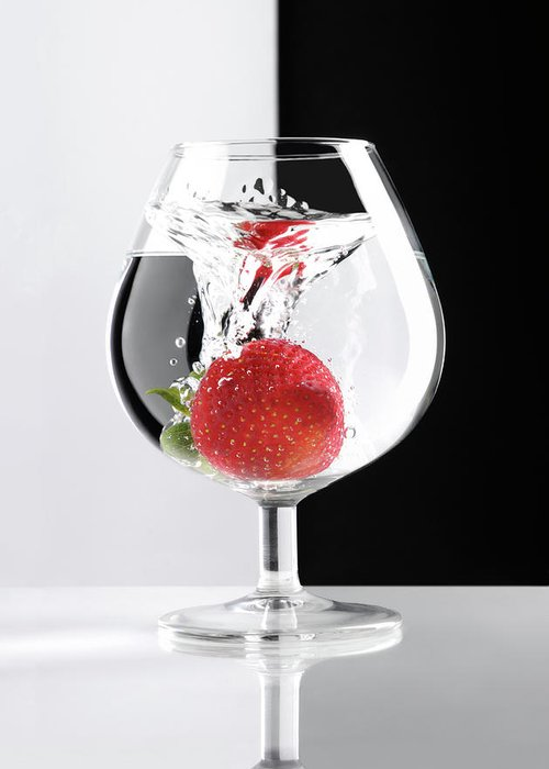 Strawberry Greeting Card featuring the photograph Strawberry In A Glass by Oleksiy Maksymenko