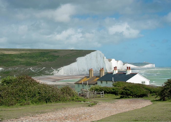 Cuckmere Haven Greeting Card featuring the photograph Sunlight On The Seven Sisters by Donald Davis