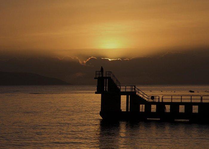 #galwaybay #galway #theprom #blackrock #salthill #ireland #travel #sunset #wildatlanticway #seascape #tourism #failteireland #sea #aranislands #silhouette #sun #irish #galwaygirl #tourism #landmark #divingboard #sundown Greeting Card featuring the photograph Sunset on Galway Bay by Rachel Dubber