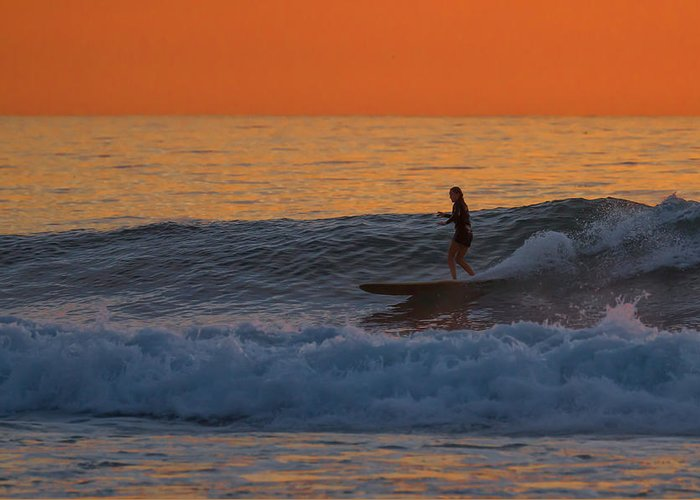 Surfer Greeting Card featuring the photograph Sunset Surfer Girl by Thomas Kaestner