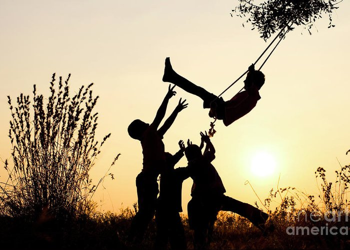 Indian Boys Greeting Card featuring the photograph Sunset Tree Swing by Tim Gainey