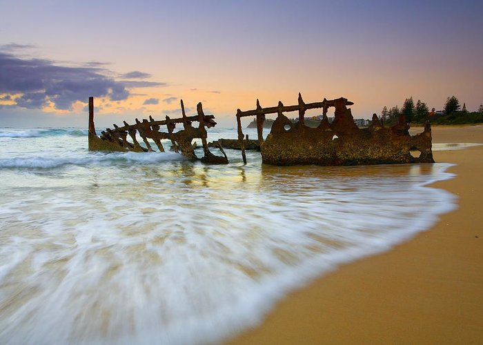 Shipwreck Greeting Card featuring the photograph Swallowed By The Tides by Mike Dawson