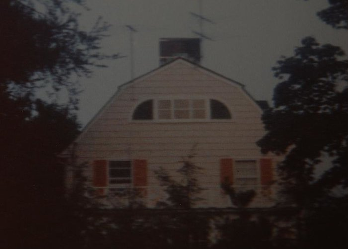 The Amityville Horror Greeting Card featuring the photograph The Amityville Horror by Rob Hans