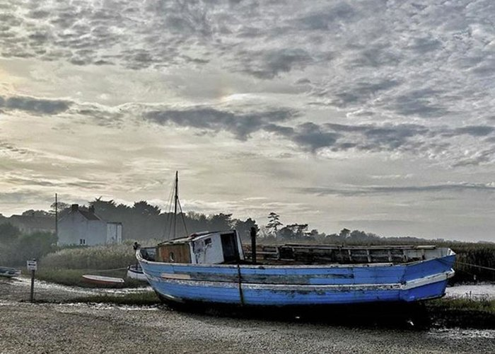Beautiful Greeting Card featuring the photograph The Fixer-upper, Brancaster Staithe by John Edwards