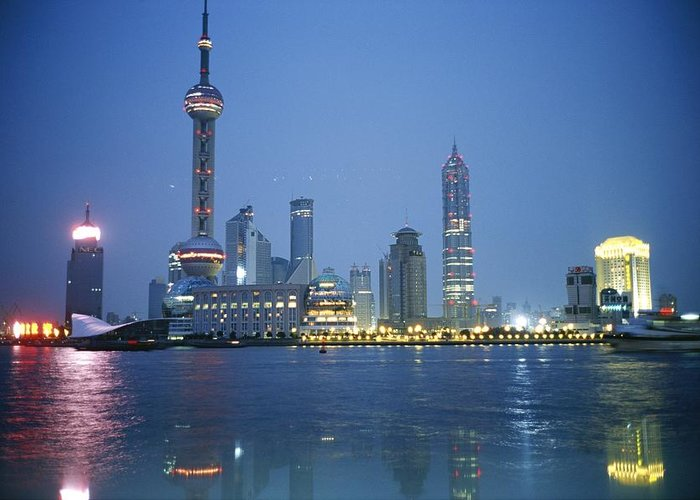 Scenes And Views Greeting Card featuring the photograph The Shanghai Skyline And Riverfront by Raul Touzon