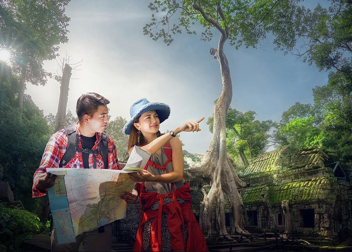 Angkor Greeting Card featuring the photograph Traveler Finding Next Camping Point By A Map by Anek Suwannaphoom