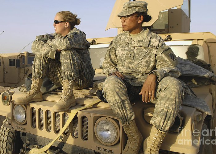Atop Greeting Card featuring the photograph Two U.s. Army Soldiers Relax Prior by Stocktrek Images