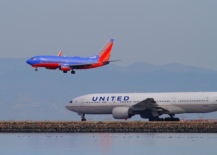 Southwest Greeting Card featuring the photograph United Airlines And Southwest Airlines Jet Airplane At San Francisco International Airport Sfo.12087 by Wingsdomain Art and Photography