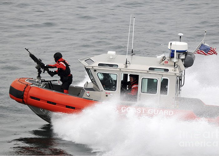 Patrol Greeting Card featuring the photograph U.s. Coast Guardsmen Aboard A Security by Stocktrek Images