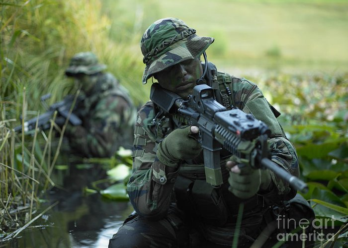 Special Operations Forces Greeting Card featuring the photograph U.s. Navy Seals Cross Through A Stream by Tom Weber