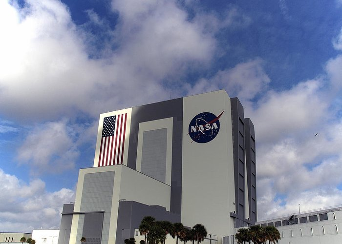Cape Greeting Card featuring the photograph Vab At Kennedy Space Center by Allan Hughes