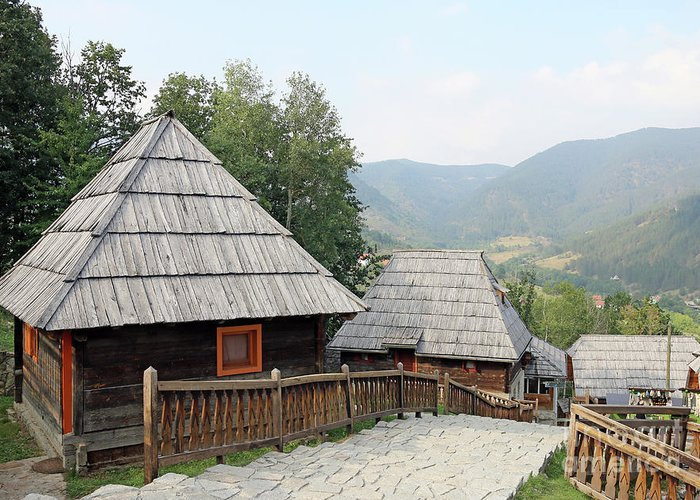 House Greeting Card featuring the photograph Village With Wooden Cabin Log On Mountain by Goce Risteski