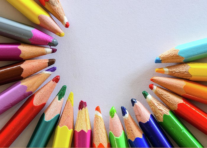 Background Greeting Card featuring the photograph Vortex Of Colored Pencils On The Sheet Of Paper by Nicola Simeoni