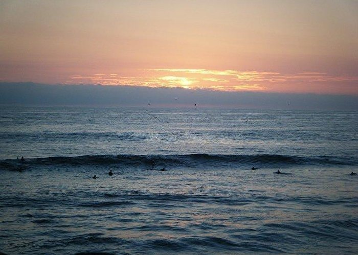 Sunset Greeting Card featuring the photograph Waiting On A Wave by Melody Glennon