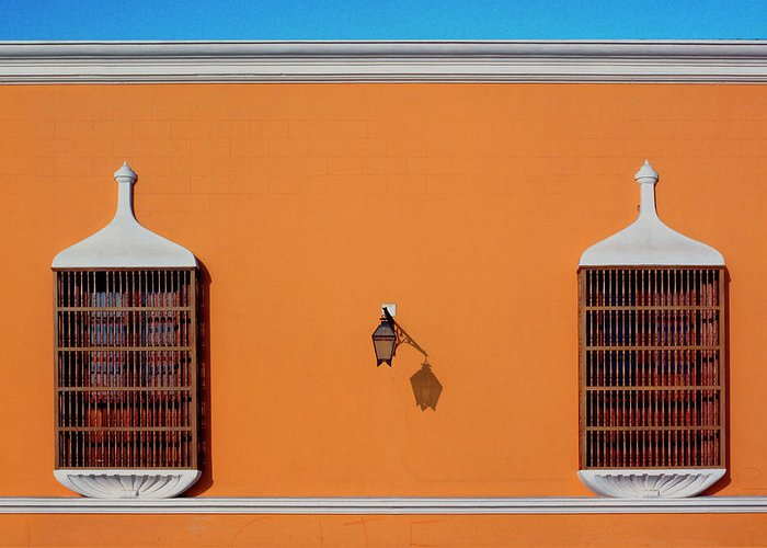 Bright Greeting Card featuring the photograph Wall Lamp And Windows In Trujillo In Peru by John Rocha