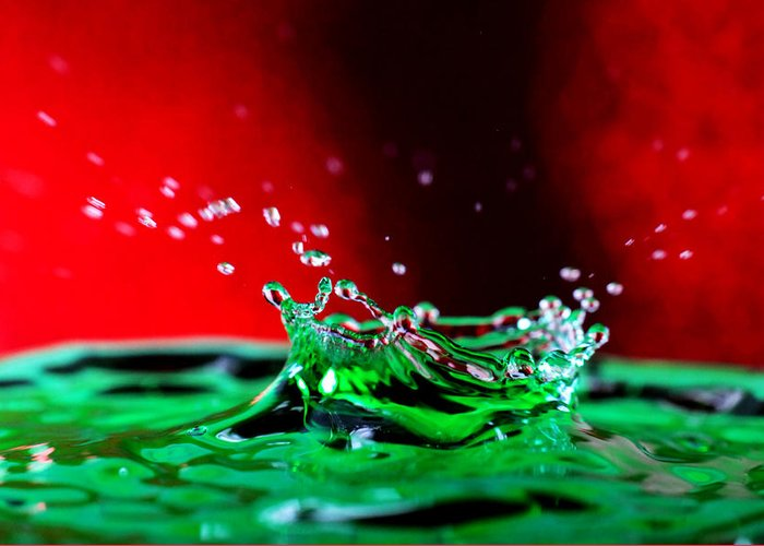 Water Greeting Card featuring the photograph Water Drop Splashing by Paul Ge