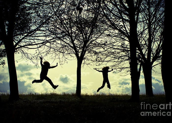 Joyful Jumping Jump Glee Forest Magical Wonderful Silhouette Two Figures Play Happiness Family Father Son Parent Child Clouds Sky Landscape Format Graphic Simple Trees Forest Woodland Memories Story Greeting Card featuring the photograph Where My Wild Things Are by Catherine MacBride
