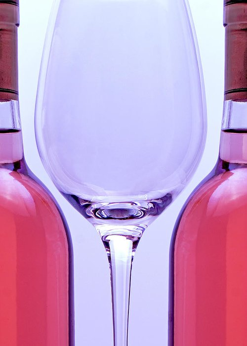 Wine Greeting Card featuring the photograph Wineglass And Bottles by Tom Mc Nemar