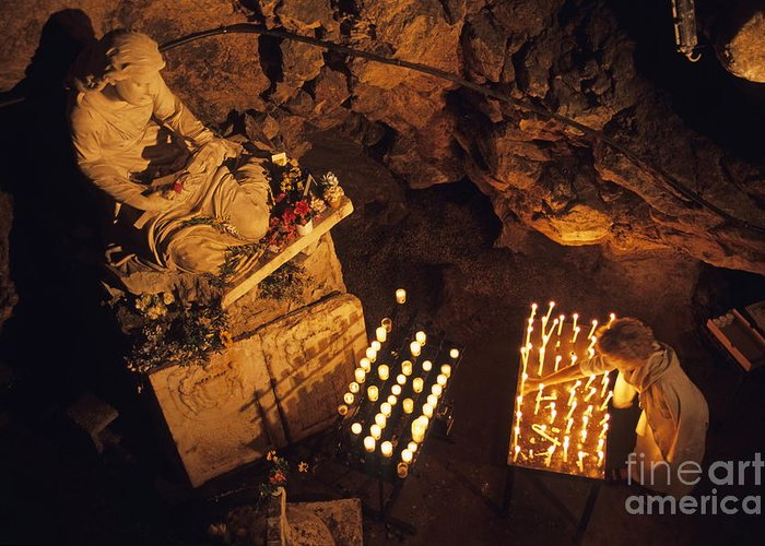 People Greeting Card featuring the photograph Woman Burning Candle At Troglodyte Sainte-marie Madeleine Holy Cave by Sami Sarkis