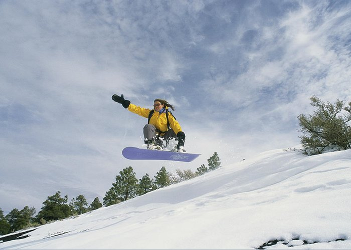 North America Greeting Card featuring the photograph Woman Snowboarding On The Cinder Cone by Kate Thompson