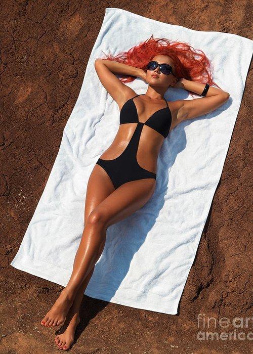 Sunbathing Greeting Card featuring the photograph Woman Sunbathing by Oleksiy Maksymenko