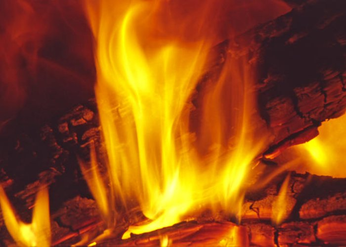 Fire Greeting Card featuring the photograph Wood Stove - Blazing Log Fire by Steve Ohlsen