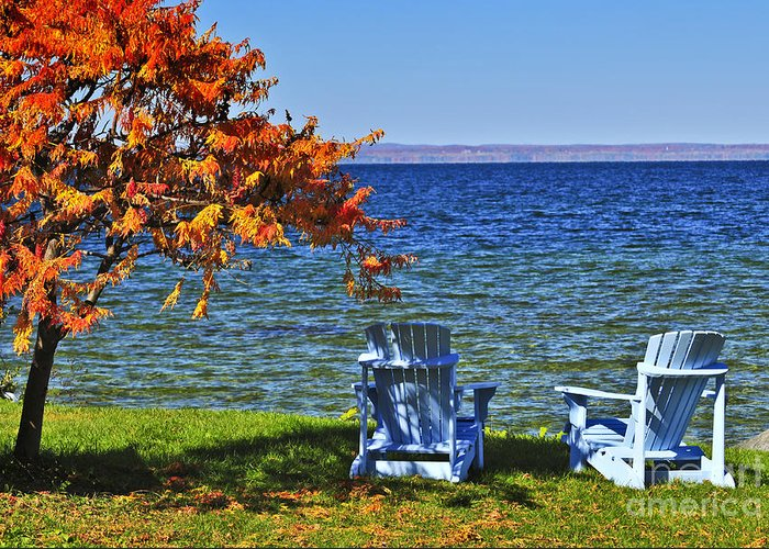 Lake Greeting Card featuring the photograph Wooden Chairs On Autumn Lake by Elena Elisseeva