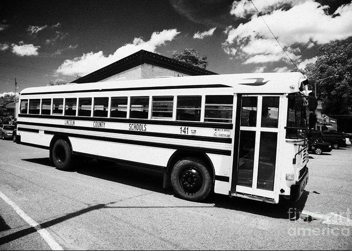 Yellow Greeting Card featuring the photograph yellow american bluebird school bus in Lynchburg tennessee usa by Joe Fox
