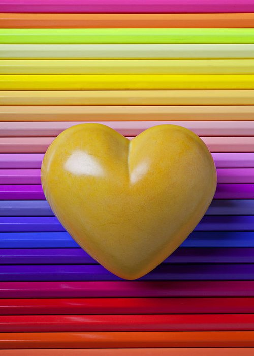Yellow Heart Stone Love Symbol Romance Greeting Card featuring the photograph Yellow Heart On Row Of Colored Pencils by Garry Gay