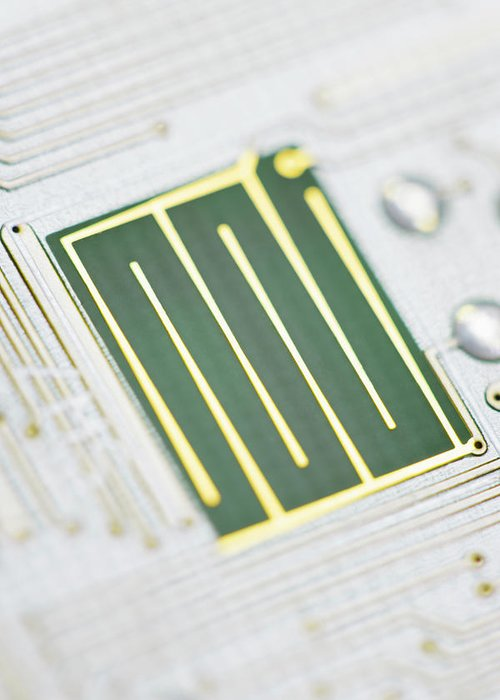 Tin Greeting Card featuring the photograph Close-up Of A Circuit Board by Nicholas Rigg