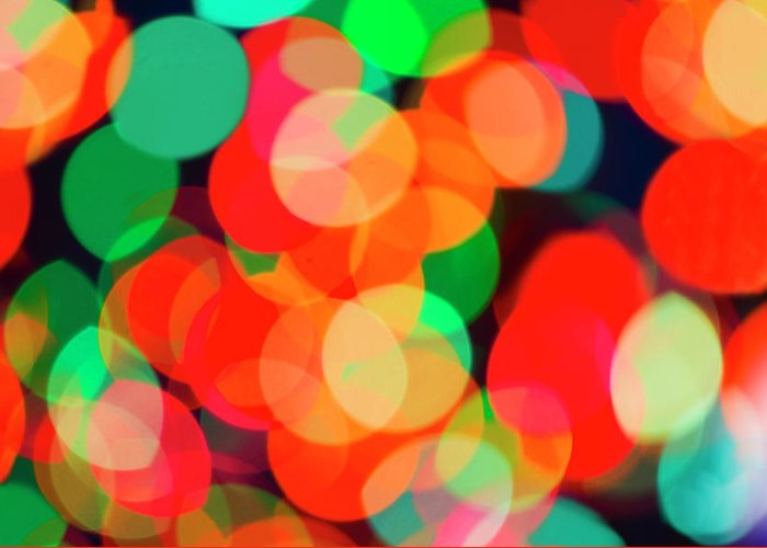 Holiday Greeting Card featuring the photograph Defocused Lights by Tetra Images